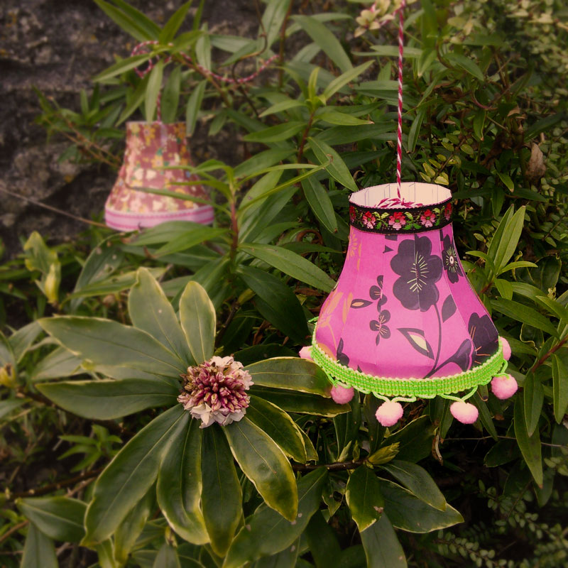 Paper lampshades strung in the garden