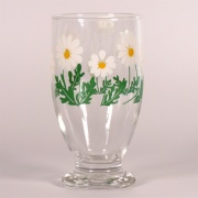 Glass footed tumbler with retro green and white daisy design
