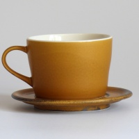 Caramel coloured Japanese cup and saucer