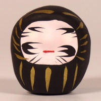 Mini traditional Japanese Daruma doll in black