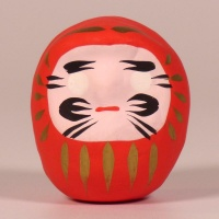 Red mini Daruma doll