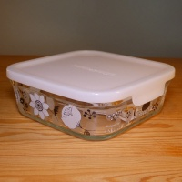 Medium-sized glass storage container with black & white floral design by Shinzi Katoh