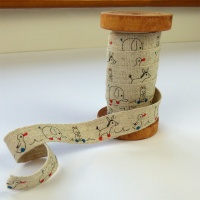 Toys linen tape on wooden reel