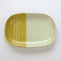 Oval Japanese ceramic plate with yellow dipped glaze design