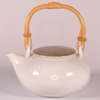 White Japanese teapot with grey lid and bamboo handle