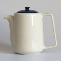 Tall white Japanese teapot with dark blue lid