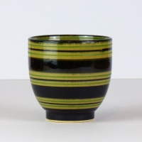 Black Japanese tea cup with green stripe pattern