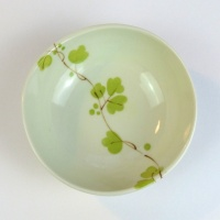 Ceramic bowl with green vine flowers pattern