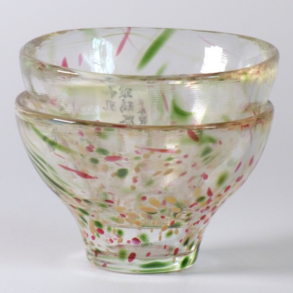 Two speckled glass Japanese sake cups