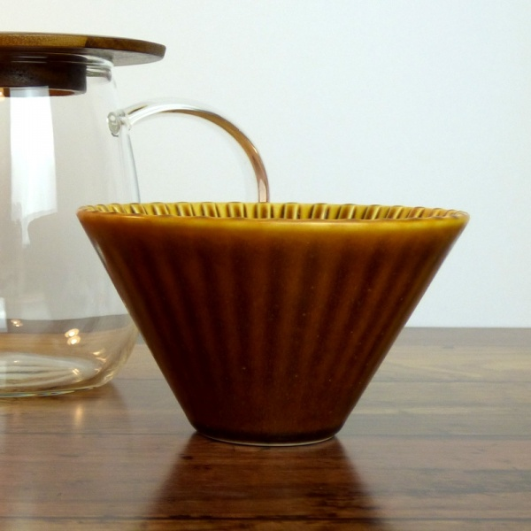 Caramel-coloured ceramic coffee filter cone