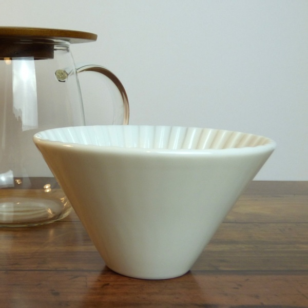 Pour-over coffee jug with white ceramic coffee filter cone