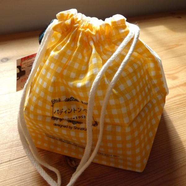 Reverse side of Paddington Bear cotton bag featuring yellow check pattern