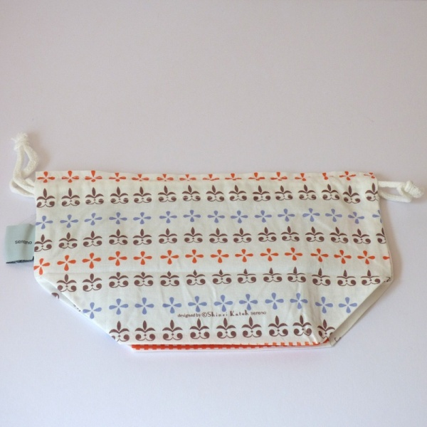Reverse side of Little Red Riding Hood cotton lunch bag featuring blue, brown and red heraldic pattern