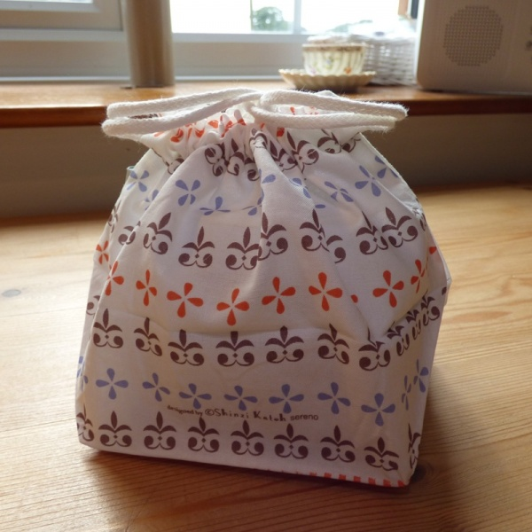 100% cotton lunch bag filled and tied at the top