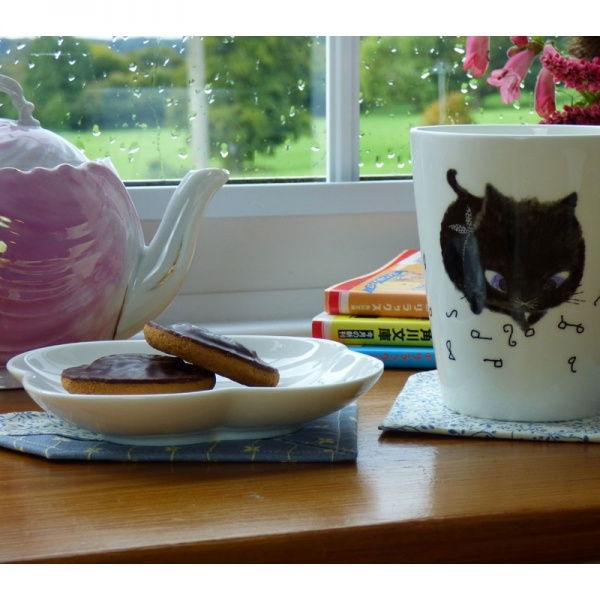 Table setting with Black Cat side plate and mug