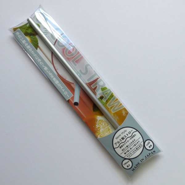 Reusable silver drinking straw in packet