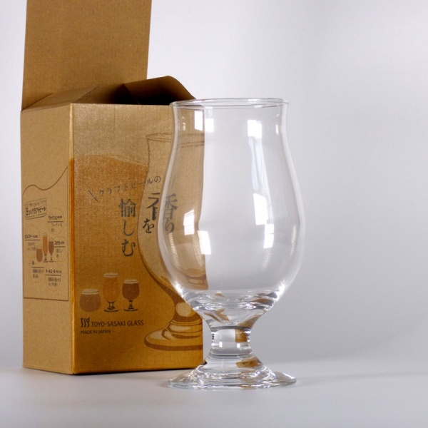 Beer glass next to box