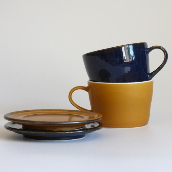 Dark blue and caramel coloured Japanese cups and saucers
