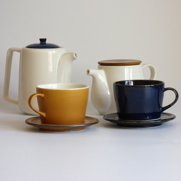 Dark blue and caramel coloured Japanese cups and saucers with Japanese teapots