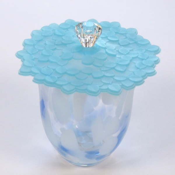 Blue Hydrangea Silicone Cup Cover on blue glass