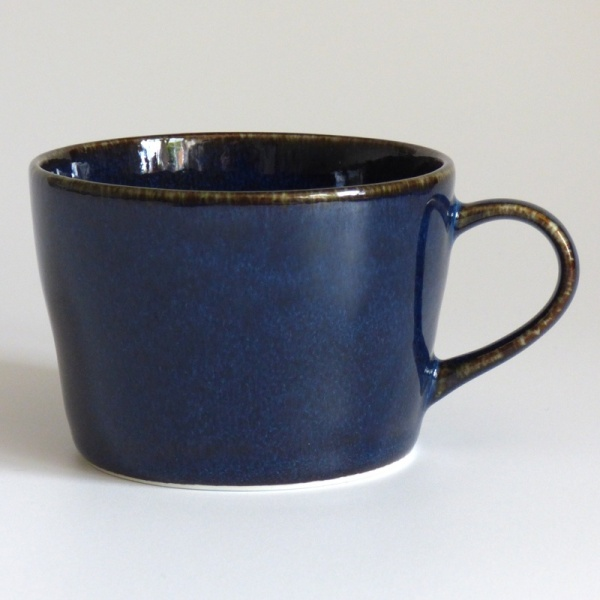 Dark blue straight sided cup without saucer