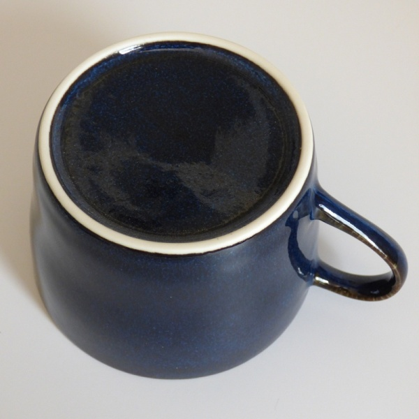 Bottom of dark blue cup