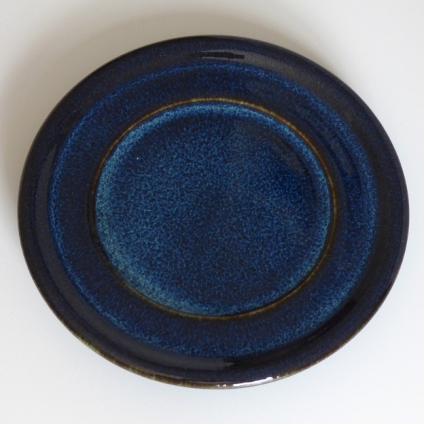 Dark blue ceramic saucer