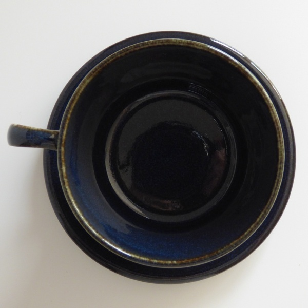 Top down, inside of dark blue cup and saucer