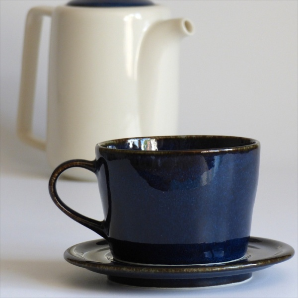 Dark blue Japanese cup and saucer with tall Japanese teapot