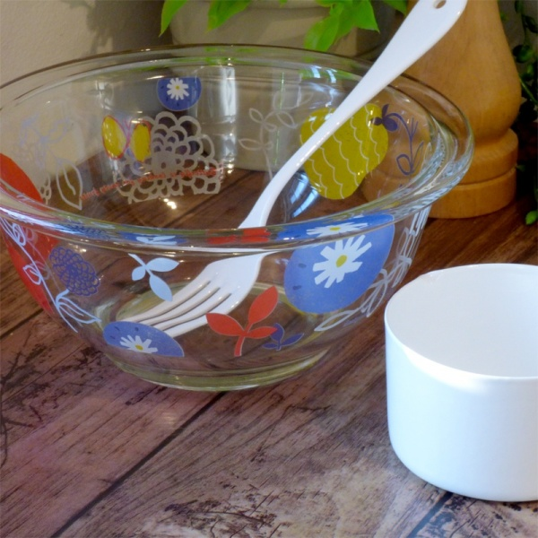 White enamel dessert fork in mixing bowl