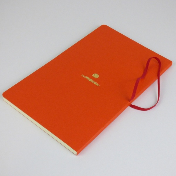 Freestyle notebook in orange 'sunset' back cover