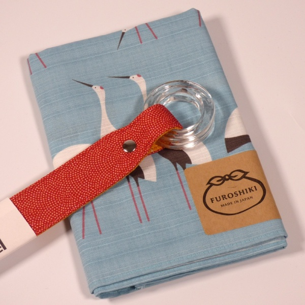 Red furoshiki handle with blue furoshiki cloth