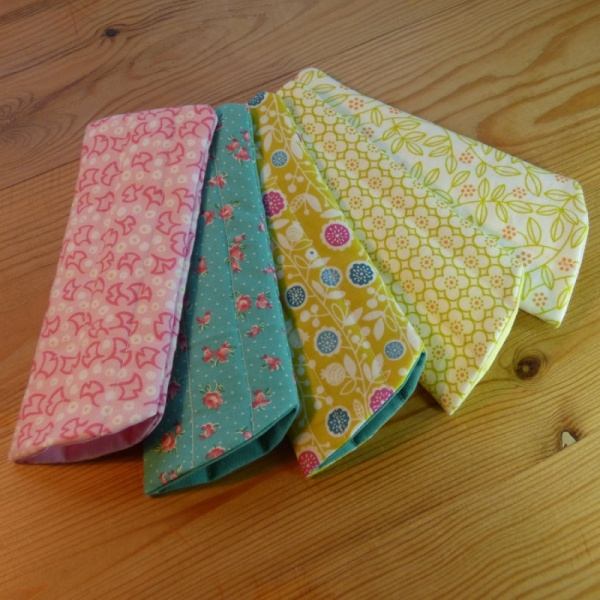 Handmade quilted glasses cases in various modern prints