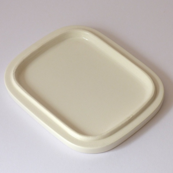 White lid of blue ceramic oven dish