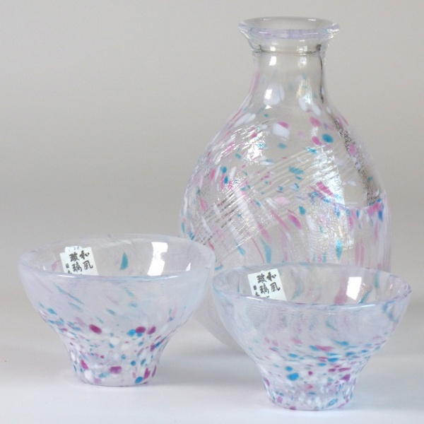 Two speckled glass Japanese sake cups with matching serving jug