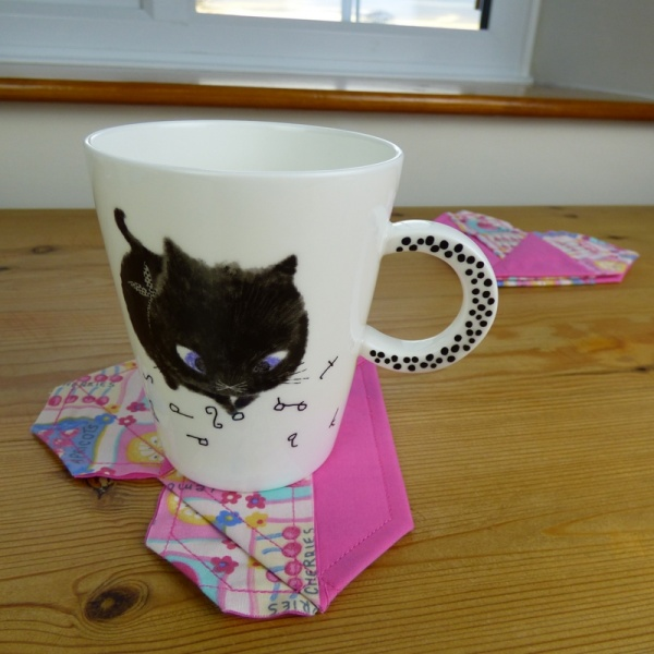 Black Cat mug on pink fabric coaster