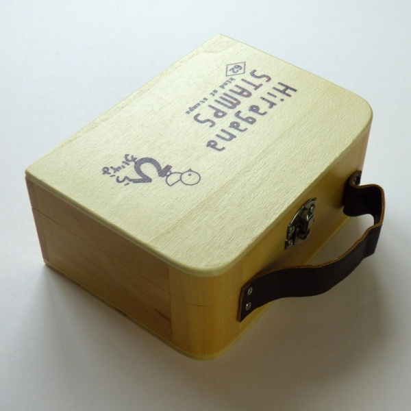 Wooden case containing hiragana stamps
