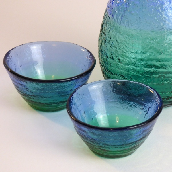 Two 'Ocean' blue green glass sake cups