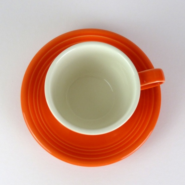 Mandarin orange coffee cup and saucer top view