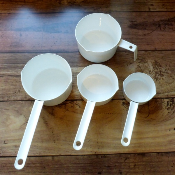 White enamel measuring cups