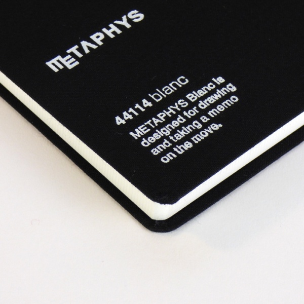 METAPHYS blanc notebook front cover detail