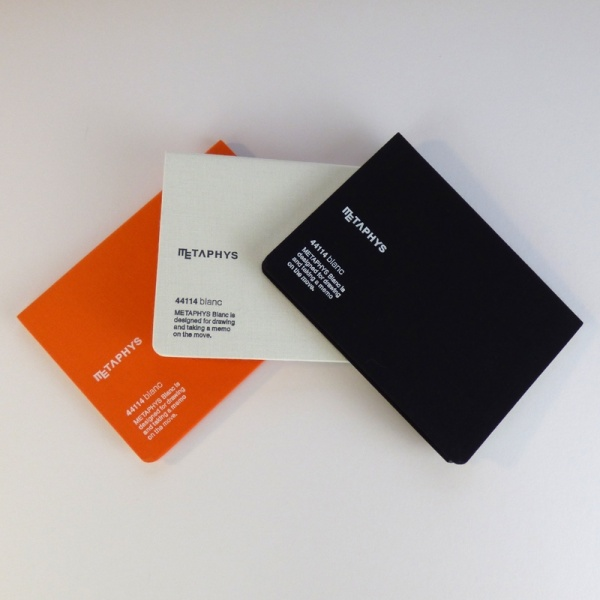 METAPHYS blanc notebooks in orange, white and black