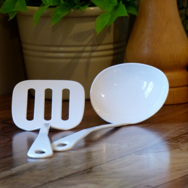 White enamel mini spatula and mini ladel in kitchen