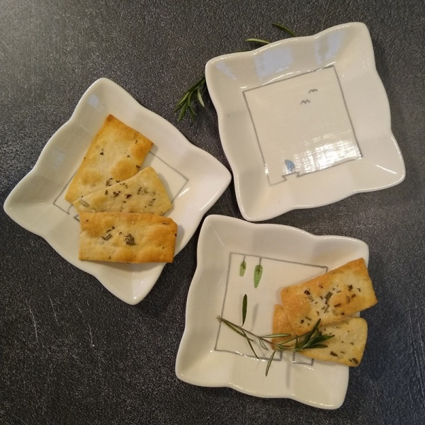 Three square mini plates with food servings
