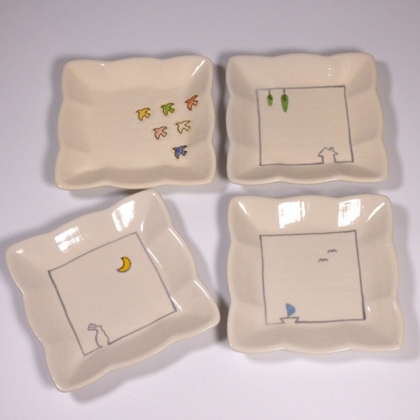 Set of four square mini plates with different designs