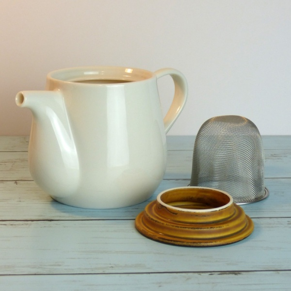 White ceramic Japanese teapot with removable strainer