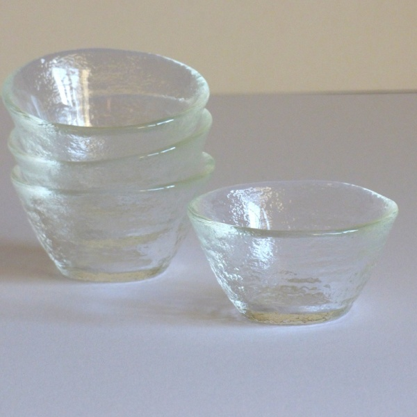 Four clear glass sake cups