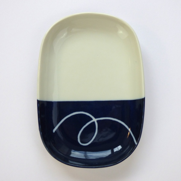 Oval Japanese ceramic plate with navy blue dipped glaze design