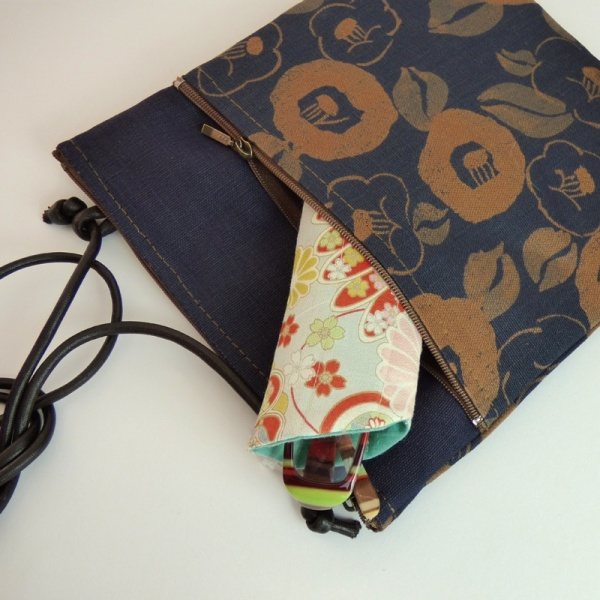 Indigo blue pochette style handbag with Camellia flower design