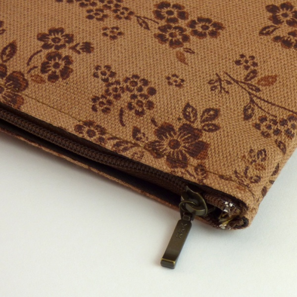 Close up of canvas zip bag with brown floral design